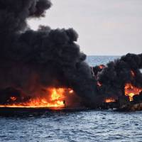Smoke and flames rise from the burning Sanchi oil tanker off the coast of eastern China on Jan. 14. | TRANSPORT MINISTRY OF CHINA / VIA AFP-JIJI