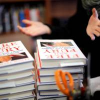 Copies of the book 'Fire and Fury: Inside the Trump White House' by author Michael Wolff are seen at a local book store in Washington Friday. | REUTERS