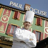 French Chef Paul Bocuse poses outside his famed Michelin three-star restaurant L'Auberge du Pont de Collonges in Collonges-au-Mont-d'or, central France, on March 24, 2011. | AP