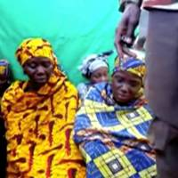 Remaining girls who were kidnapped from the northeast Nigerian town of Chibok are seen in an unknown location in Nigeria in this still image taken from an undated video obtained on Monday. | BOKO HARAM HANDOUT / SAHARA REPORTERS / VIA REUTERS