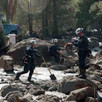 Rescue workers search through properties after a mudslide in Montecito, California, Thursday. | REUTERS