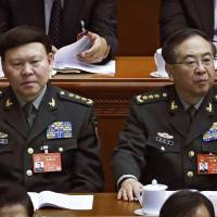 Gen. Fang Fenghui (right), the then-chief of the general staff of the Chinese People's Liberation Army, and Gen. Zhang Yang, the then-head of China's People's Liberation Army political affairs department attend the China's National People's Congress at the Great Hall of the People in Beijing in March.   AP