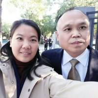 Chinese lawyer Yu Wensheng and his wife, Xu Yan, pose for a selfie in Beijing in October 2017. | AP