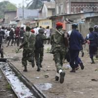 Congolese forces kill at least seven during protests over president's refusal to step down