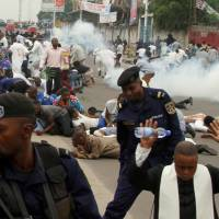Riot police fire tear gas to disperse Catholic priests and demonstrators during a protest against President Joseph Kabila, organized by the Catholic church in Kinshasa Sunday. | REUTERS