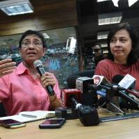 Maria Ressa (left), CEO and editor of online portal Rappler, speaks during a news conference at its office in Manila on Monday as Acting Managing Editor Chay Hofilena listens. | AFP-JIJI
