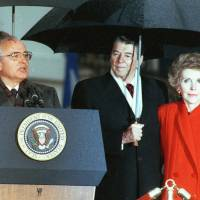 Then-Soviet leader Mikhail Gorbachev speaks on Dec. 10, 1987, alongside U.S. President Ronald Reagan and first lady Nancy Reagan at a ceremony ending his official visit to the White House. | REUTERS