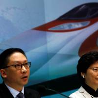 Hong Kong Chief Executive Carrie Lam and Justice Secretary Rimsky Yuen attend a news conference on arrangements at the new West Kowloon Terminus for the Guangzhou-Shenzhen-Hong Kong express rail Link in Hong Kong last Wednesday. | REUTERS