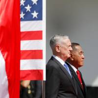 Indonesia's Defense Minister Ryamizard Ryacudu and visiting U.S. Secretary of Defense Jim Mattis are seen during a welcome ceremony in Jakarta on Jan. 23.   REUTERS