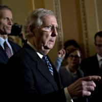 Senate Majority Leader Mitch McConnell, a Republican from Kentucky, speaks during a news conference after a weekly caucus meeting at the U.S. Capitol in Washington on Tuesday. | BLOOMBERG