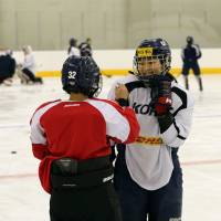 Players from North and South Korean women's ice hockey teams talk during a training session at Jincheon National Training Center in Jincheon, South Korea, on Sunday. | REUTERS