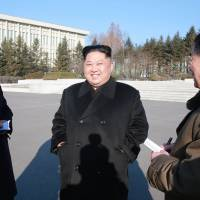 This undated picture released from North Korea's official Korean Central News Agency on Thursday shows North Korean leader Kim Jong Un inspecting the State Academy of Sciences at an undisclosed location. | AFP-JIJI