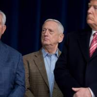 U.S. Secretary of Defense Jim Mattis is flanked by President Donald Trump (right) and Secretary of State Rex Tillerson during a retreat with Republican lawmakers and members of his Cabinet at Camp David in Thurmont, Maryland, on Jan. 6.   AFP-JIJI