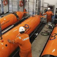Autonomous underwater vehicles (AUVs) that will be used in the ocean search for the wreckage of missing Malaysia Airlines Flight MH370 are seen in this undated handout picture released Wednesday. | OCEAN INFINITY / VIA AP