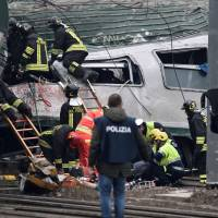 Three dead and scores injured as commuter train derails near Milan, Italy