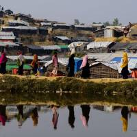 Village burns in Myanmar's Rakhine state: Bangladesh official