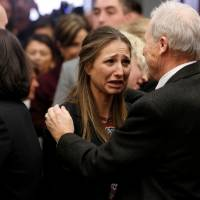 Michigan State University Police Chief Jim Dunlap embraces victim Kyle Stephens after the sentencing of Larry Nassar, a former team USA Gymnastics doctor who pleaded guilty in November  to sexual assault charges, in Lansing, Michigan, Wednesday. | REUTERS