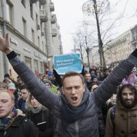 Russian opposition leader Alexei Navalny attends a rally in Moscow Sunday. Navalny was arrested Sunday in Moscow while walking with protesters, as protests take place across the country. | AP
