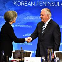 U.S. Secretary of State Rex Tillerson shakes hands with South Korean Foreign Minister Kang Kyung-wha at the Vancouver Foreign Ministers Meeting on Security and Stability on the Korean Peninsula in Vancouver, British Columbia, on Tuesday. | AFP-JIJI