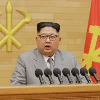 North Korean leader Kim Jong Un gives his annual New Year's Day speech in this photo released on Jan. 1. | REUTERS