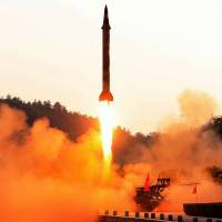 This undated photo released in May shows the test-firing of a North Korean ballistic missile from an undisclosed location in the country.   KCNA VIA KNS / VIA AFP-JIJI