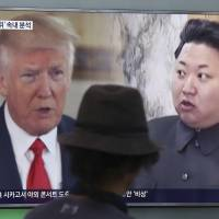 A man watches a TV screen showing U.S. President Donald Trump and North Korean leader Kim Jong Un during a news program at Seoul Railway Station in the South Korean capital in August.   AP