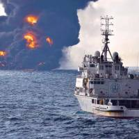 Smoke and flames rise from the burning Sanchi oil tanker at sea off the coast of eastern China on Sunday. | AFP-JIJI
