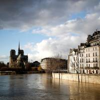 The rear of the Notre Dame Cathedral in Paris is seen Friday as the muddy Seine River covers its banks after days of almost nonstop rain caused flooding in France.   REUTERS