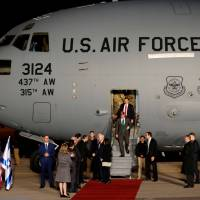 U.S. Vice President Mike Pence is greeted by Israeli officials upon his arrival at Ben Gurion international Airport in Lod, near Tel Aviv Sunday. | REUTERS