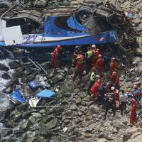 At least 36 dead when bus plunges off 'Devil's Curve' onto rocky beach in Peru
