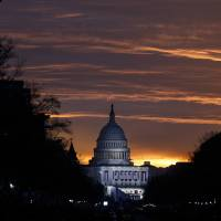 The U.S. Capitol is illuminated during sunrise in Washington. The same Russian government-aligned hackers who penetrated the Democratic Party have spent the past few months laying the groundwork for an espionage campaign against the U.S. Senate, the cybersecurity firm Trend Micro said Friday. | AP