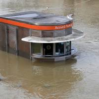 Paris under control as Seine flood looks to crest but other towns waterlogged
