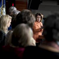 House Minority Leader Nancy Pelosi, a Democrat from California, speaks during a news conference with other House Democratic women on Capitol Hill in Washington on Sunday. | BLOOMBERG