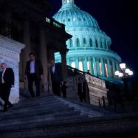 Members of the House of Representatives leave after a vote on Capitol Hill to end the U.S. government shutdown on Monday in Washington. | AFP-JIJI