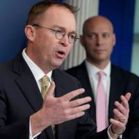 Office of Management and Budget Director Mick Mulvaney (left) speaks as Legislative Affairs Director Marc Short looks on during a news briefing at the White House in Washington on Saturday. | AFP-JIJI