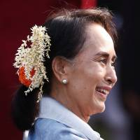 Myanmar State Counsellor Aung San Suu Kyi smiles as she attends the 'At Home' reception at the Rashtrapati Bhavan presidential palace after an India Republic Day parade in New Delhi on Friday. | REUTERS