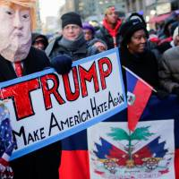 Hundreds converge on Times Square to protest racism and denounce Trump