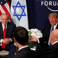 Trump in Davos tells Palestinians to 'respect' U.S. and join peace talks or face aid cutoff