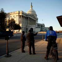 U.S. Capitol policemen stand in front of the U.S. Capitol before U.S. President Donald Trump delivers his first State of the Union address in Washington Tuesday. | REUTERS