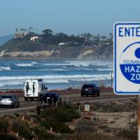 A tsunami sign is shown along the coastal highway in Cardiff, California, Tuesday. | REUTERS