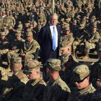 Defense Secretary Jim Mattis talks to troops at an outdoor movie theater at Guantanamo Bay, Cuba, on Dec. 21. The unannounced visit was the first by a defense secretary since Donald Rumsfeld visited in January 2002 shortly after the first prisoners arrived from Afghanistan. | AP