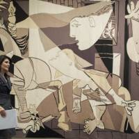 United States Ambassador to the United Nations Nikki Haley walks past a reproduction of Pablo Picasso's 'Guernica' tapestry as she arrives to speak to reporters Tuesday at United Nations headquarters. | AP