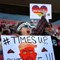 One of the many attendees makes her point during the Women's March Anniversary 'Power To The Polls' event Sunday at Sam Boyd Stadium in Las Vegas. The rally is aimed at starting a national campaign to register voters, increase support for women and secure progressive seats in the upcoming midterm elections. | AFP-JIJI