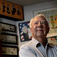 Mort Walker, the artist and author of the 'Beetle Bailey' comic strip, stands in his studio in Stamford, Connecticutt, in 2010. On Saturday, a family member said the comic strip artist has died. He was 94. | AP