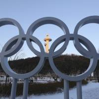 The Olympic rings are displayed at the Main Press Center for the 2018 Pyeongchang Winter Olympics in Pyeongchang, South Korea, Tuesday. Prime Minister Shinzo Abe is planning to attend the opening ceremony, a source in Tokyo said.   AP