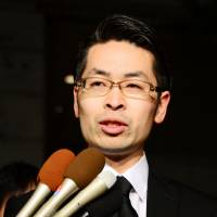 Coincheck executive Yusuke Otsuka fields questions from reporters in Tokyo's Chiyoda Ward on Sunday. | KYODO