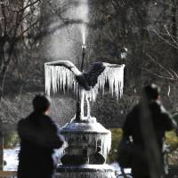 Icicles formed on a fountain at Tokyo's Hibiya Park on Thursday morning as temperatures marked a 48-year low in the capital. The reading of minus 4 degrees Celsius prompted warnings about freezing pipes and strain on the power grid. | KYODO