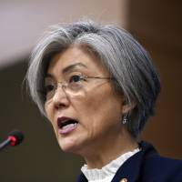 South Korean Foreign Minister Kang Kyung-wha speaks during a briefing on the 2015 South Korea-Japan agreement over 'comfort women' at the Foreign Ministry in Seoul on Tuesday. | AP