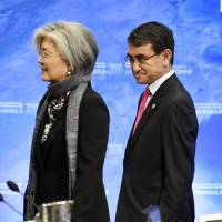 South Korean Foreign Minister Kang Kyung-wha (left) and Japanese Foreign Minister Taro Kono attend a 20-nation ministerial meeting on North Korea Tuesday in Vancouver., British Columbia. | KYODO