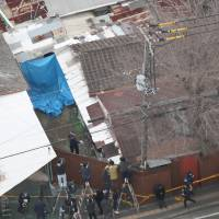 This aerial photo shows a house in the city of Neyagawa, Osaka, where a couple was allegedly confining their 33-year-old daughter who died last month. | KYODO